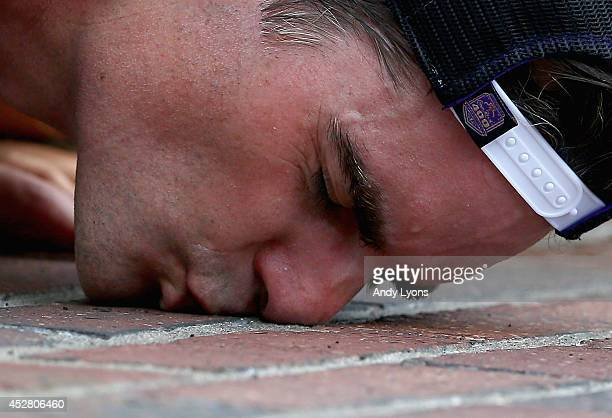 Jeff Gordon driver of the Axalta Chevrolet celebrates by kissing the bricks after winning the NASCAR Sprint Cup Series Crown Royal Presents The John...