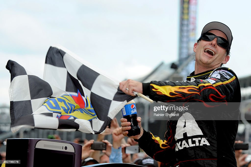 <a gi-track='captionPersonalityLinkClicked' href=/galleries/search?phrase=Jeff+Gordon&family=editorial&specificpeople=171491 ng-click='$event.stopPropagation()'>Jeff Gordon</a>, driver of the #24 Axalta Chevrolet, celebrates in Victory Lane after winning the NASCAR Sprint Cup Series Crown Royal Presents The John Wayne Walding 400 at the Brickyard Indianapolis Motor Speedway on July 27, 2014 in Indianapolis, Indiana.
