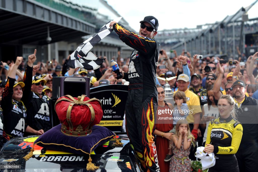 Jeff Gordon, driver of the #24 Axalta Chevrolet, celebrates in Victory Lane after winning the NASCAR Sprint Cup Series Crown Royal Presents The John Wayne Walding 400 at the Brickyard Indianapolis Motor Speedway on July 27, 2014 in Indianapolis, Indiana.