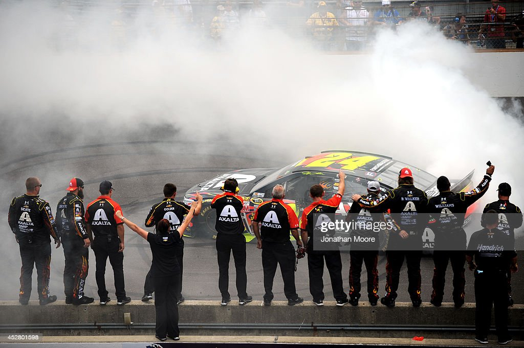 <a gi-track='captionPersonalityLinkClicked' href=/galleries/search?phrase=Jeff+Gordon&family=editorial&specificpeople=171491 ng-click='$event.stopPropagation()'>Jeff Gordon</a>, driver of the #24 Axalta Chevrolet, celebrates with a burnout after winning the NASCAR Sprint Cup Series Crown Royal Presents The John Wayne Walding 400 at the Brickyard Indianapolis Motor Speedway on July 27, 2014 in Indianapolis, Indiana.