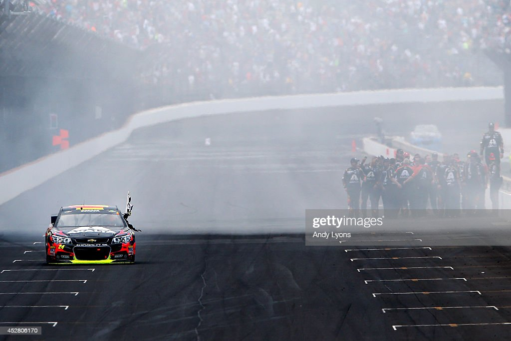 Jeff Gordon, driver of the #24 Axalta Chevrolet, celebrates with a burnout and the checkered flag after winning the NASCAR Sprint Cup Series Crown Royal Presents The John Wayne Walding 400 at the Brickyard Indianapolis Motor Speedway on July 27, 2014 in Indianapolis, Indiana.
