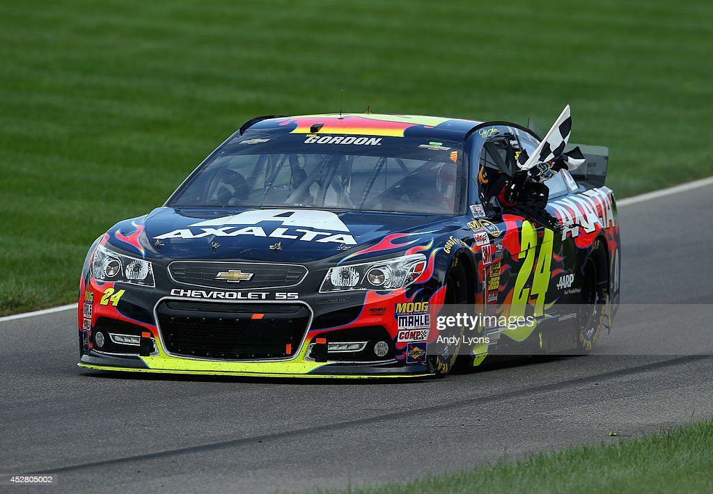Jeff Gordon, driver of the #24 Axalta Chevrolet, celebrates with the checkered flag after winning the NASCAR Sprint Cup Series Crown Royal Presents The John Wayne Walding 400 at the Brickyard Indianapolis Motor Speedway on July 27, 2014 in Indianapolis, Indiana.