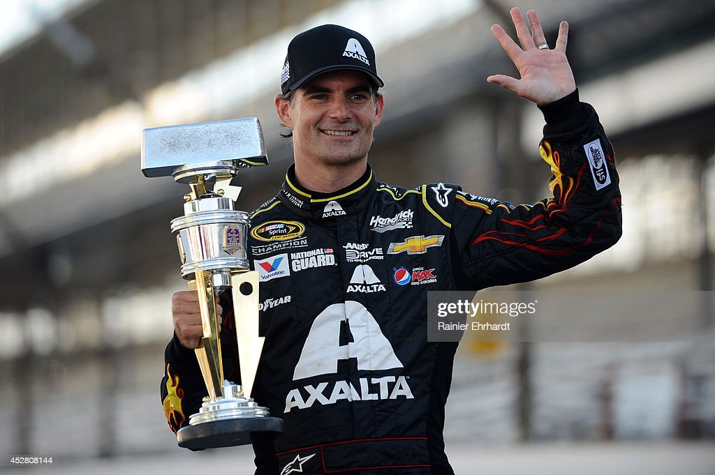 Jeff Gordon, driver of the #24 Axalta Chevrolet, celebrates with the trophy after winning the NASCAR Sprint Cup Series Crown Royal Presents The John Wayne Walding 400 at the Brickyard Indianapolis Motor Speedway on July 27, 2014 in Indianapolis, Indiana.