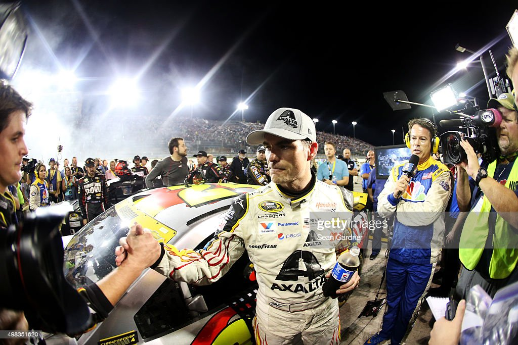 Jeff Gordon, driver of the #24 AXALTA Chevrolet, climbs from his car after placing sixth in the NASCAR Sprint Cup Series Ford EcoBoost 400 at Homestead-Miami Speedway on November 22, 2015 in Homestead, Florida.