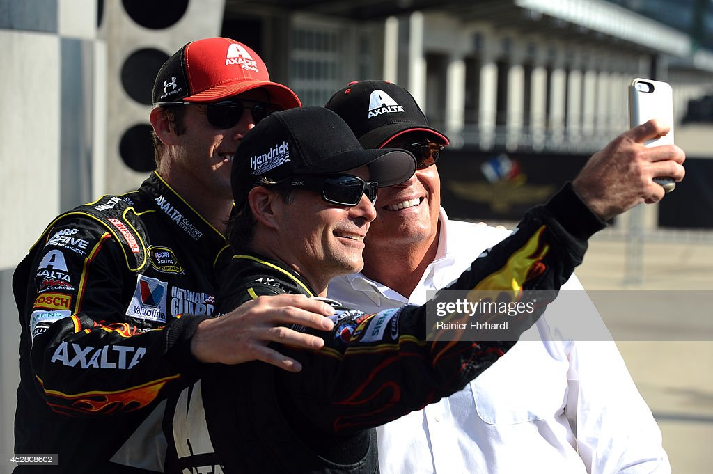Jeff Gordon driver of the Axalta Chevrolet crew chief Alan Gustafson and team owner Rick Hendrick take a selfie in Victory Lane after winning the...