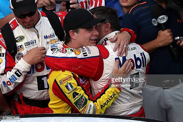 Jeff Gordon driver of the Axalta Chevrolet hugs Tony Stewart driver of the Mobil 1/Chevy Summer Sell Down Chevrolet after the NASCAR Sprint Cup...