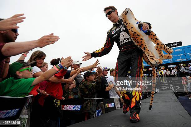 Jeff Gordon driver of the Axalta Chevrolet is introduced prior to the NASCAR Sprint Cup Series Pure Michigan 400 at Michigan International Speedway...