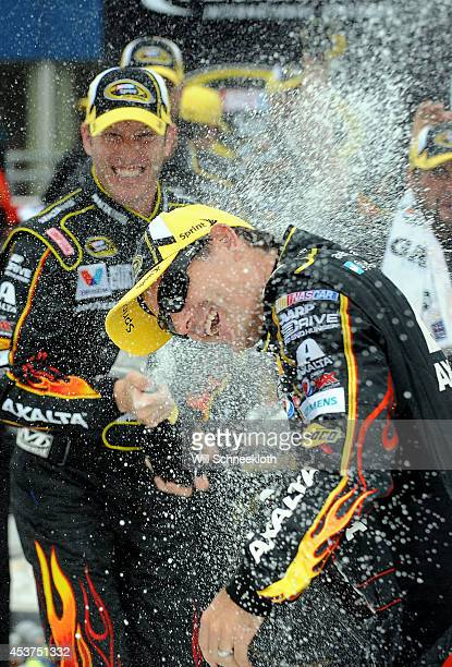 Jeff Gordon driver of the Axalta Chevrolet is sprayed with champagne by his crew chief Alan Gustafson in victory lane after winning the NASCAR Sprint...