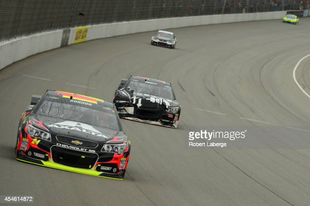 Jeff Gordon driver of the Axalta Chevrolet leads a pack of cars during the NASCAR Sprint Cup Series Pure Michigan 400 at Michigan International...