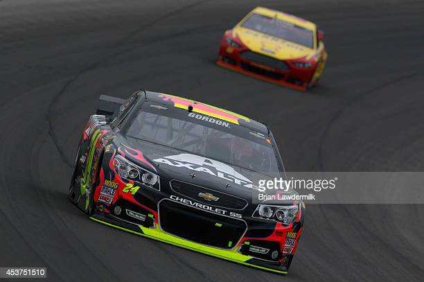 Jeff Gordon driver of the Axalta Chevrolet leads Joey Logano driver of the ShellPennzoil Ford during the NASCAR Sprint Cup Series Pure Michigan 400...