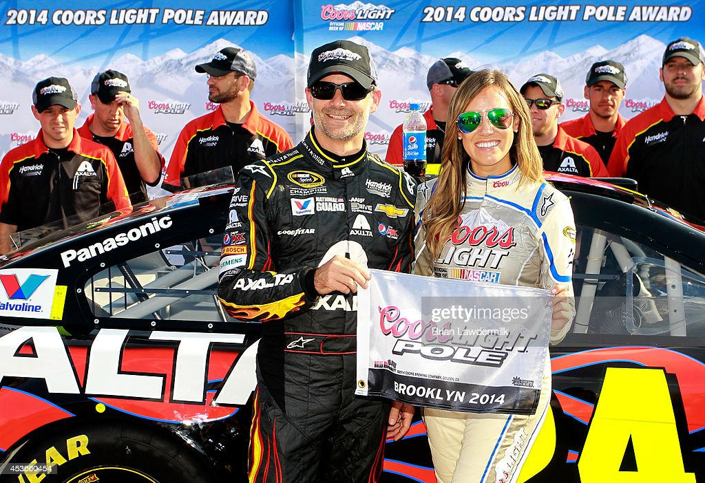 Jeff Gordon, driver of the #24 Axalta Chevrolet, poses with Miss Coors Light, Rachel Rupert, after winning the Coors Light Pole Award during qualifying for the NASCAR Sprint Cup Series Pure Michigan 400 at Michigan International Speedway on August 15, 2014 in Brooklyn, Michigan.