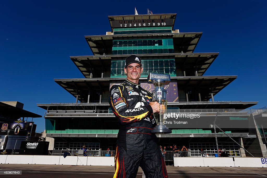 <a gi-track='captionPersonalityLinkClicked' href=/galleries/search?phrase=Jeff+Gordon&family=editorial&specificpeople=171491 ng-click='$event.stopPropagation()'>Jeff Gordon</a>, driver of the #24 Axalta Chevrolet, poses with the trophy after winning the NASCAR Sprint Cup Series Crown Royal Presents The John Wayne Walding 400 at the Brickyard Indianapolis Motor Speedway on July 27, 2014 in Indianapolis, Indiana.