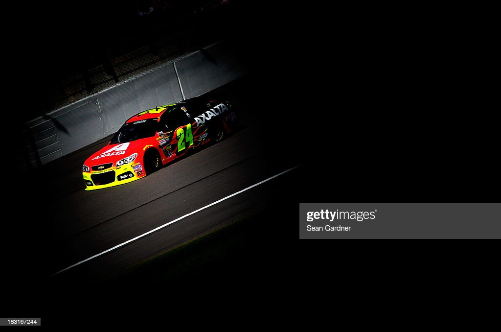 <a gi-track='captionPersonalityLinkClicked' href=/galleries/search?phrase=Jeff+Gordon&family=editorial&specificpeople=171491 ng-click='$event.stopPropagation()'>Jeff Gordon</a>, driver of the #24 Axalta Chevrolet, practices for the NASCAR Sprint Cup Series 13th Annual Hollywood Casino 400 at Kansas Speedway on October 5, 2013 in Kansas City, Kansas.