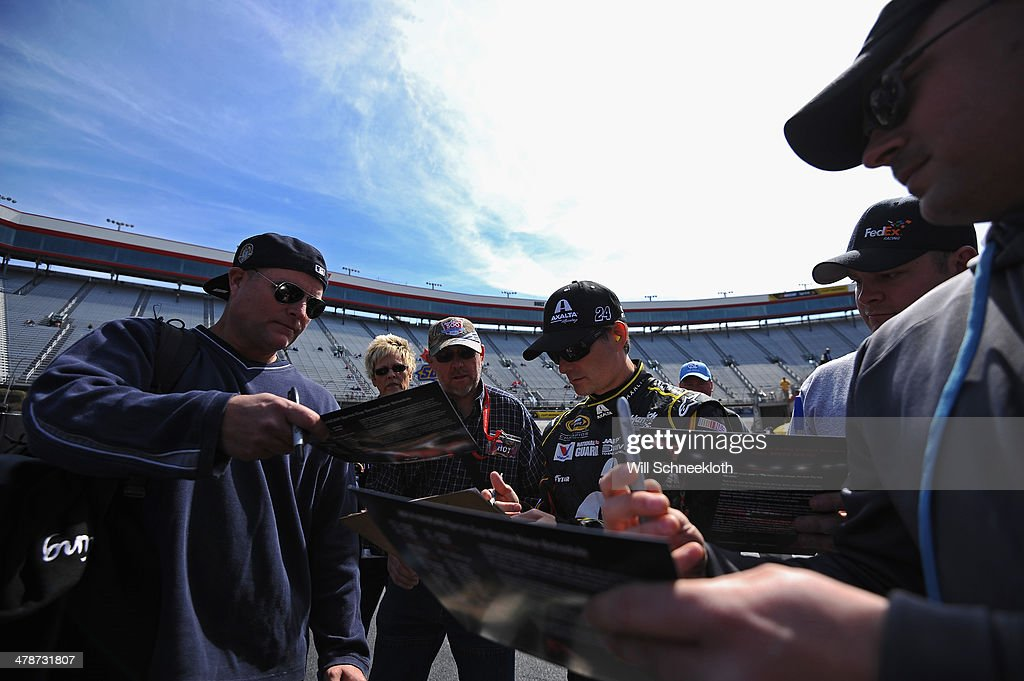 <a gi-track='captionPersonalityLinkClicked' href=/galleries/search?phrase=Jeff+Gordon&family=editorial&specificpeople=171491 ng-click='$event.stopPropagation()'>Jeff Gordon</a>, driver of the #24 Axalta Chevrolet, signs autographs during practice for the NASCAR Sprint Cup Series Food City 500 at Bristol Motor Speedway on March 14, 2014 in Bristol, Tennessee.
