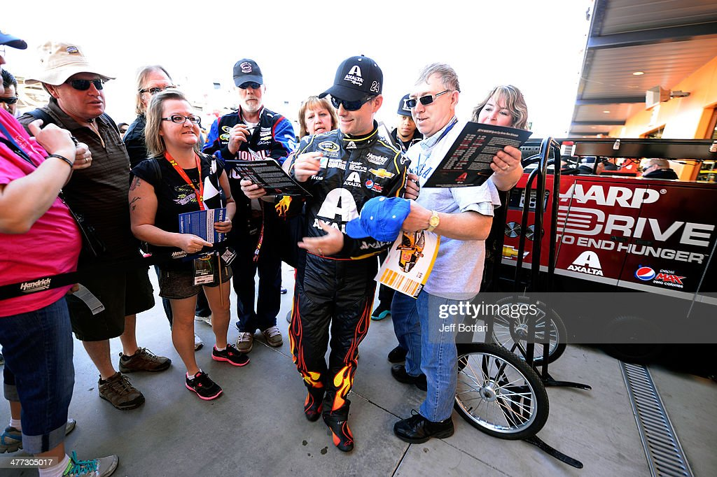 <a gi-track='captionPersonalityLinkClicked' href=/galleries/search?phrase=Jeff+Gordon&family=editorial&specificpeople=171491 ng-click='$event.stopPropagation()'>Jeff Gordon</a>, driver of the #24 Axalta Chevrolet, signs autographs for fans during practice for the NASCAR Sprint Cup Series Kobalt 400 at Las Vegas Motor Speedway on March 8, 2014 in Las Vegas, Nevada.