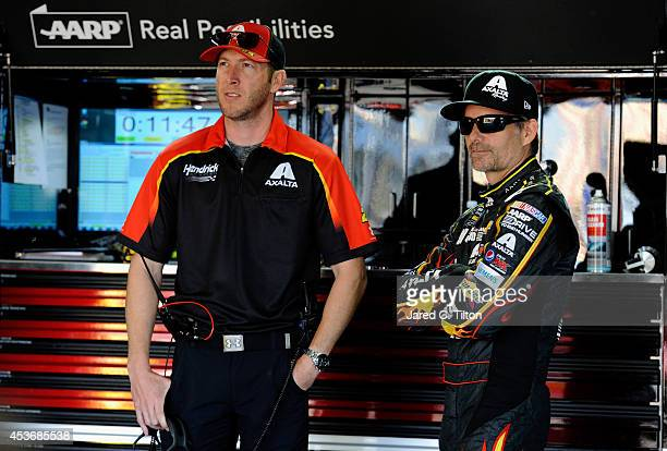 Jeff Gordon driver of the Axalta Chevrolet speaks with his crew chief Alan Gustafson in the garage during practice for the NASCAR Sprint Cup Series...