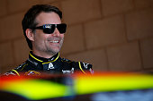 Jeff Gordon driver of the Axalta Chevrolet stands in the garage area during practice for the NASCAR Sprint Cup Series Auto Club 400 at Auto Club...