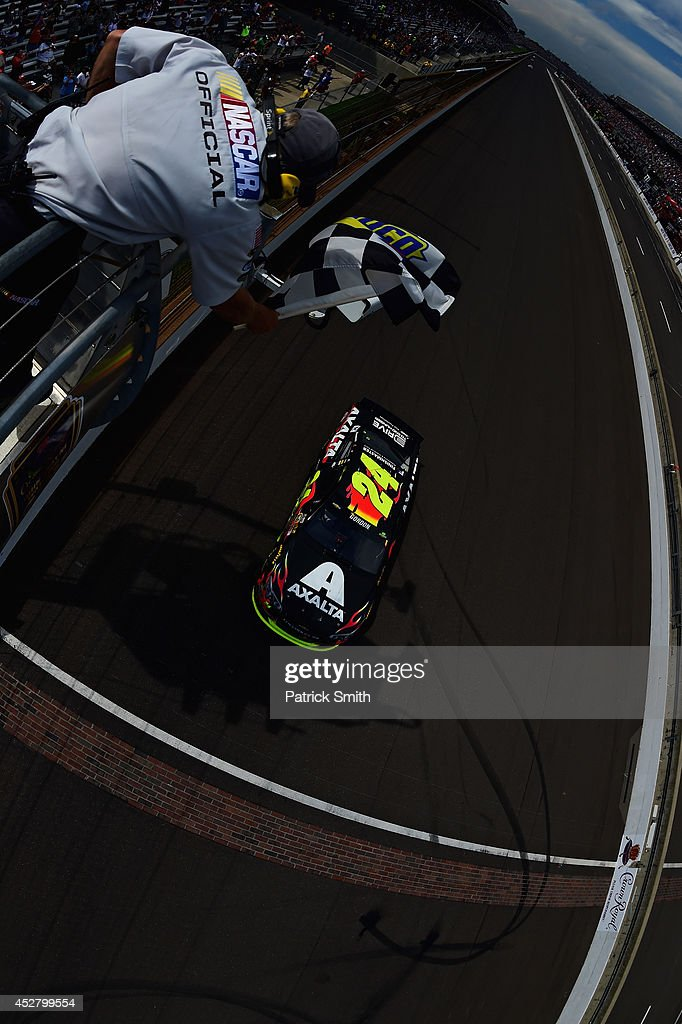 <a gi-track='captionPersonalityLinkClicked' href=/galleries/search?phrase=Jeff+Gordon&family=editorial&specificpeople=171491 ng-click='$event.stopPropagation()'>Jeff Gordon</a>, driver of the #24 Axalta Chevrolet, takes the checkered flag to win the NASCAR Sprint Cup Series Crown Royal Presents The John Wayne Walding 400 at the Brickyard Indianapolis Motor Speedway on July 27, 2014 in Indianapolis, Indiana.