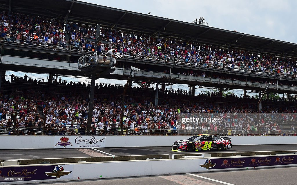 Jeff Gordon, driver of the #24 Axalta Chevrolet, takes the checkered flag to win the NASCAR Sprint Cup Series Crown Royal Presents The John Wayne Walding 400 at the Brickyard Indianapolis Motor Speedway on July 27, 2014 in Indianapolis, Indiana.
