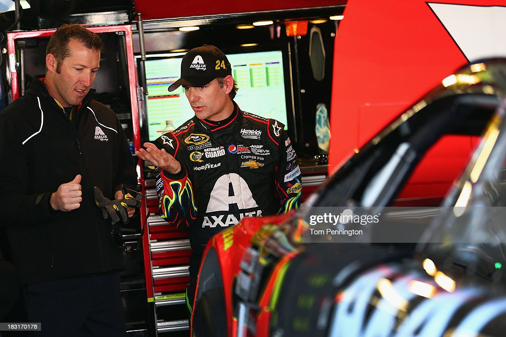 Jeff Gordon, driver of the #24 Axalta Chevrolet, talks to crew chief Alan Gustafson in the garage area during practice for the NASCAR Sprint Cup Series 13th Annual Hollywood Casino 400 at Kansas Speedway on October 5, 2013 in Kansas City, Kansas.
