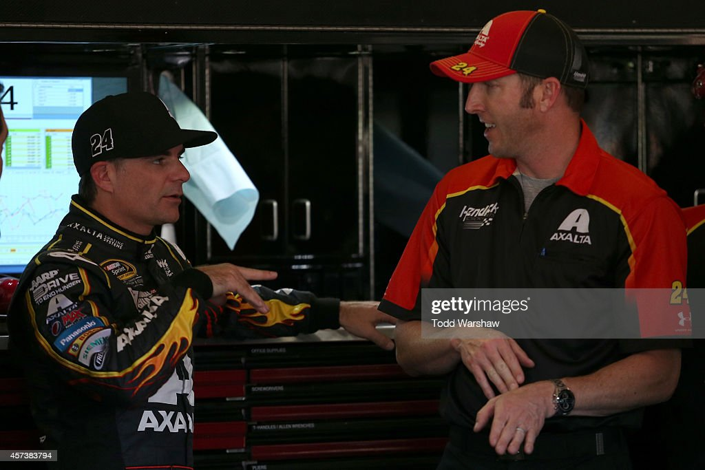 Jeff Gordon driver of the Axalta Chevrolet talks to his crew chief Alan Gustafson in the garage area during practice for the NASCAR Sprint Cup Series...