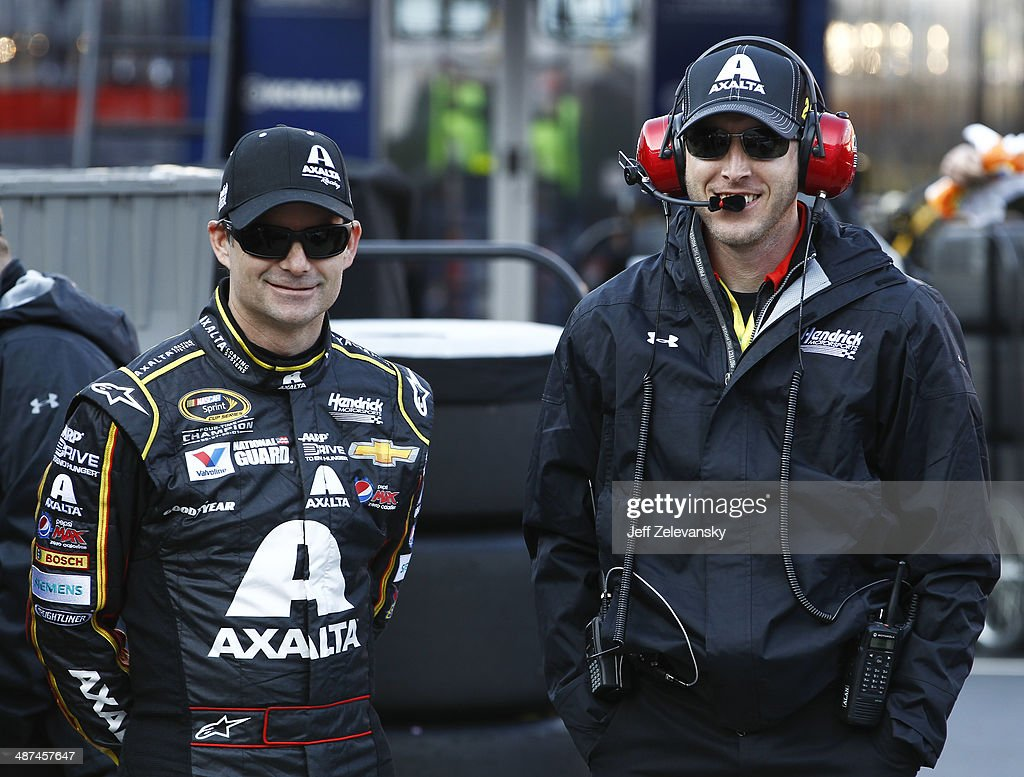 Jeff Gordon driver of the Axalta Chevrolet talks with crew chief Alan Gustafson during practice for the NASCAR Sprint Cup Series Food City 500 at...