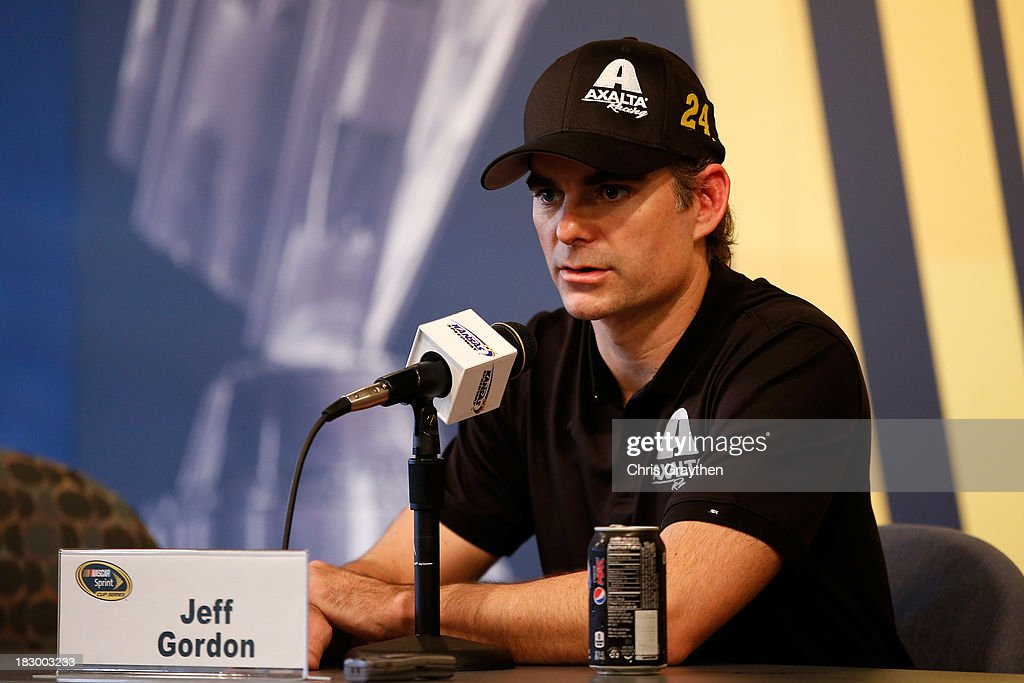 <a gi-track='captionPersonalityLinkClicked' href=/galleries/search?phrase=Jeff+Gordon&family=editorial&specificpeople=171491 ng-click='$event.stopPropagation()'>Jeff Gordon</a>, driver of the #24 Axalta Chevrolet, talks with the media following testing for the NASCAR Sprint Cup Series at Kansas Speedway on October 3, 2013 in Kansas City, Kansas.