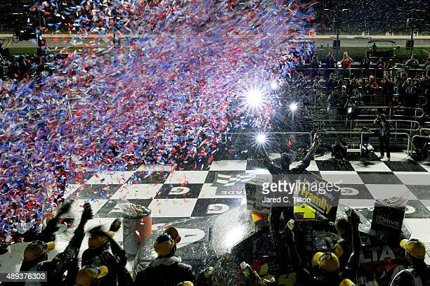 Jeff Gordon driver of the Axalta Coatings Chevrolet celebrates in victory lane after winning the NASCAR Sprint Cup Series 5Hour Energy 400 at Kansas...