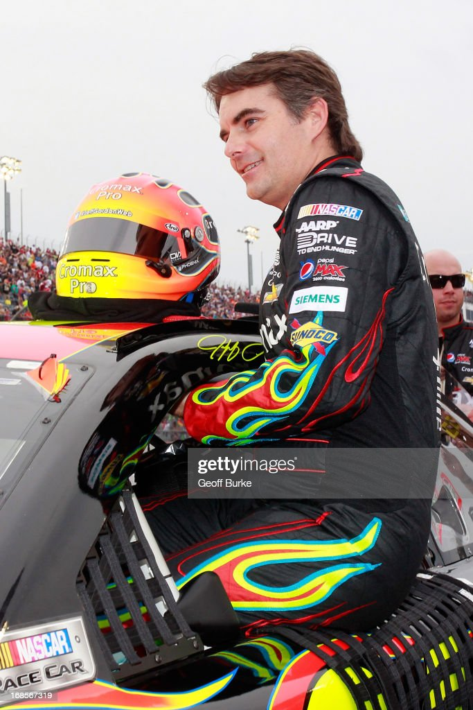Jeff Gordon, driver of the #24 Cromax Pro Chevrolet, climbs into his car during the NASCAR Sprint Cup Series Bojangles' Southern 500 at Darlington Raceway on May 11, 2013 in Darlington, South Carolina.