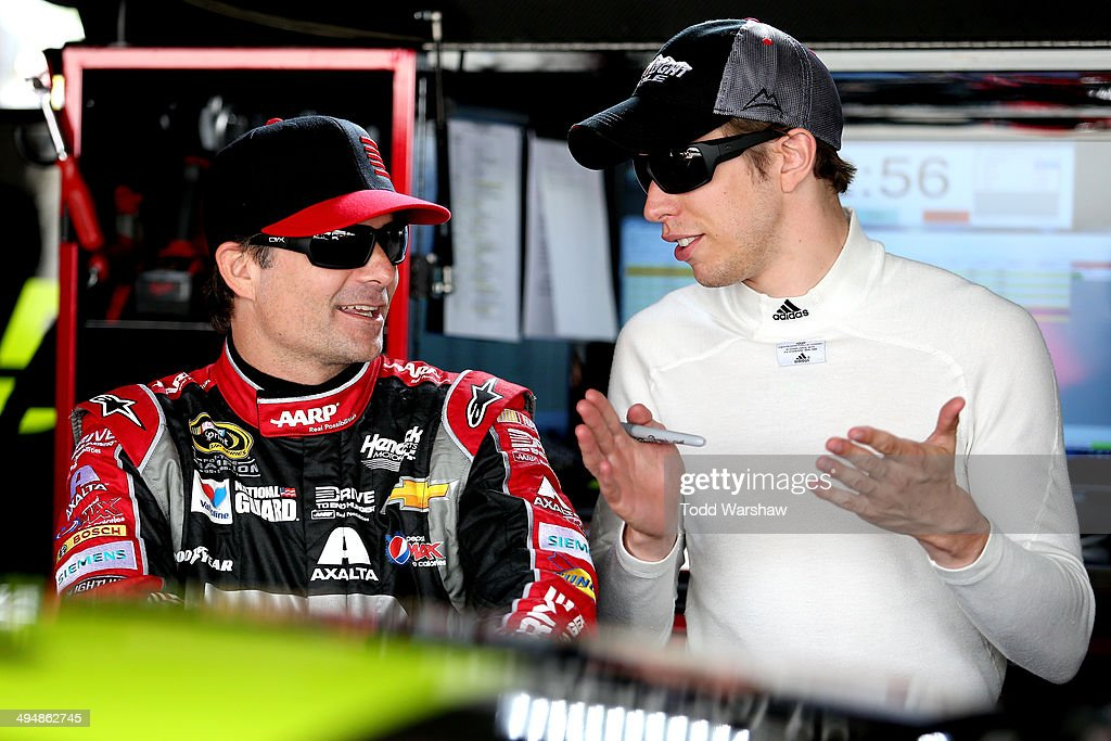<a gi-track='captionPersonalityLinkClicked' href=/galleries/search?phrase=Jeff+Gordon&family=editorial&specificpeople=171491 ng-click='$event.stopPropagation()'>Jeff Gordon</a>, driver of the #24 DRive to End Hunger Chevrolet, and <a gi-track='captionPersonalityLinkClicked' href=/galleries/search?phrase=Brad+Keselowski&family=editorial&specificpeople=890258 ng-click='$event.stopPropagation()'>Brad Keselowski</a>, driver of the #2 Miller Lite Ford, talk in the garage during practice for the NASCAR Sprint Cup Series FedEx 400 Benefiting Autism Speaks at Dover International Speedway on May 31, 2014 in Dover, Delaware.
