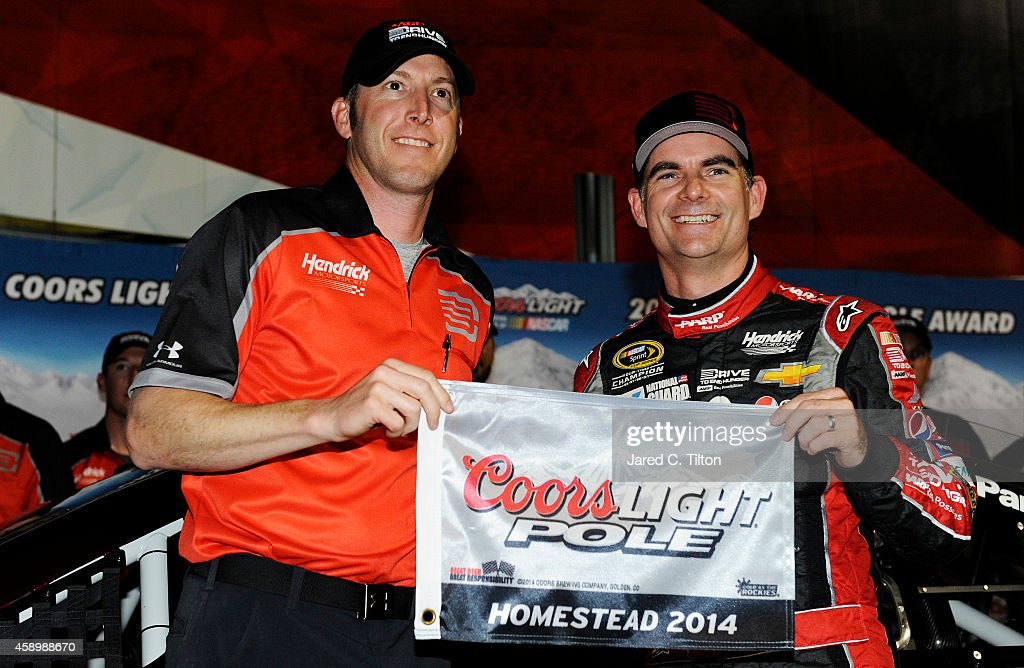 Jeff Gordon driver of the Drive To End Hunger Chevrolet and crew chief Alan Gustafson pose with the Coors Light Pole Award after qualifying for pole...