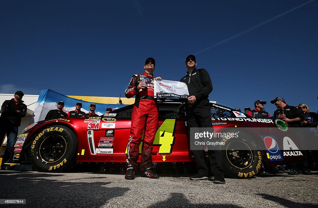 Jeff Gordon driver of the Drive To End Hunger Chevrolet and his crew chief Alan Gustafson pose with the Coors Light Pole Award after qualifying for...