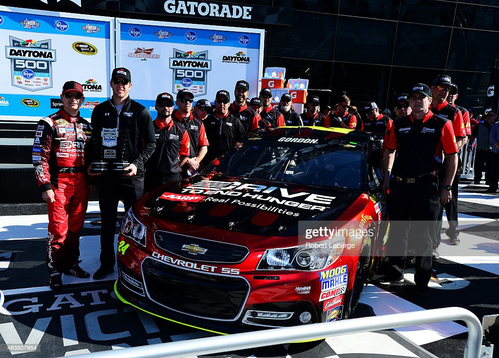 Jeff Gordon driver of the Drive To End Hunger Chevrolet and his crew chief Alan Gustafson pose with the Daytona 500 Pole Award after qualifying for...
