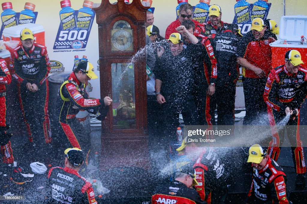 <a gi-track='captionPersonalityLinkClicked' href=/galleries/search?phrase=Jeff+Gordon&family=editorial&specificpeople=171491 ng-click='$event.stopPropagation()'>Jeff Gordon</a>, driver of the #24 Drive To End Hunger Chevrolet, and his team celebrate in victory lane after winning the NASCAR Sprint Cup Series Goody's Headache Relief Shot 500 Powered By Kroger at Martinsville Speedway on October 27, 2013 in Martinsville, Virginia.