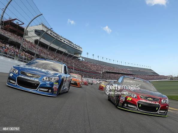 Jeff Gordon driver of the Drive To End Hunger Chevrolet and Jimmie Johnson driver of the Lowe's Chevrolet lead the field during pace laps prior to...