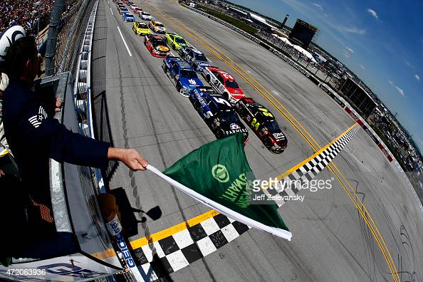 General view as Jeff Gordon driver of the Drive To End Hunger Chevrolet and Kasey Kahne driver of the Farmers Insurance Chevrolet lead the field past...