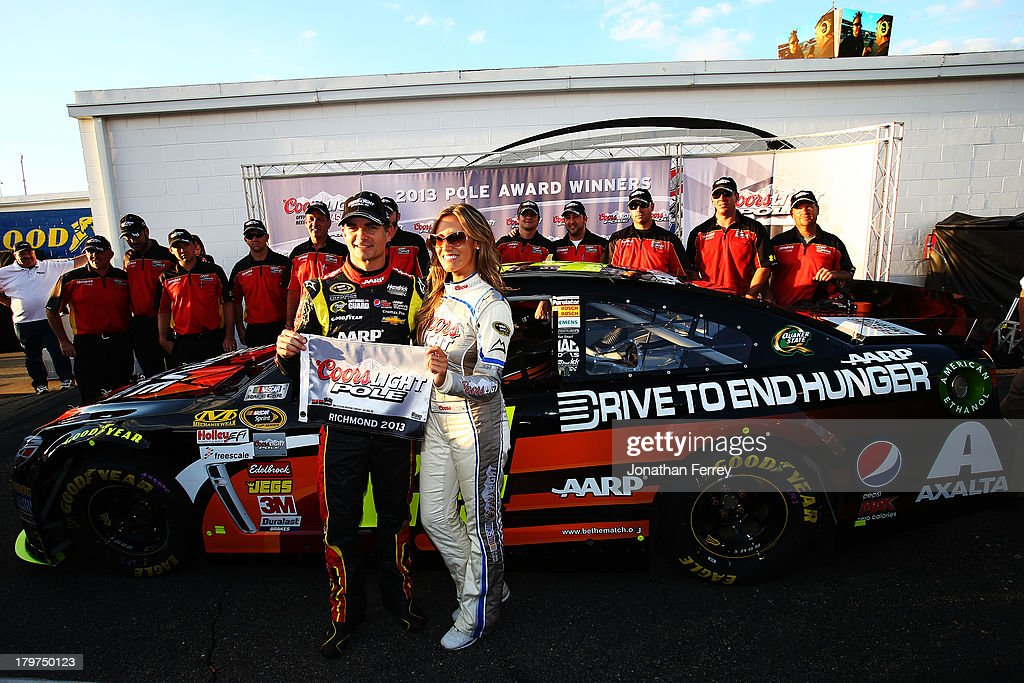 <a gi-track='captionPersonalityLinkClicked' href=/galleries/search?phrase=Jeff+Gordon&family=editorial&specificpeople=171491 ng-click='$event.stopPropagation()'>Jeff Gordon</a>, driver of the #24 Drive to End Hunger Chevrolet, and Miss Coors Light Rachel Rupert pose with the Coors Light Pole Award after Gordon qualified for the pole for the NASCAR Sprint Cup Series Federated Auto Parts 400 at Richmond International Raceway on September 6, 2013 in Richmond, Virginia.
