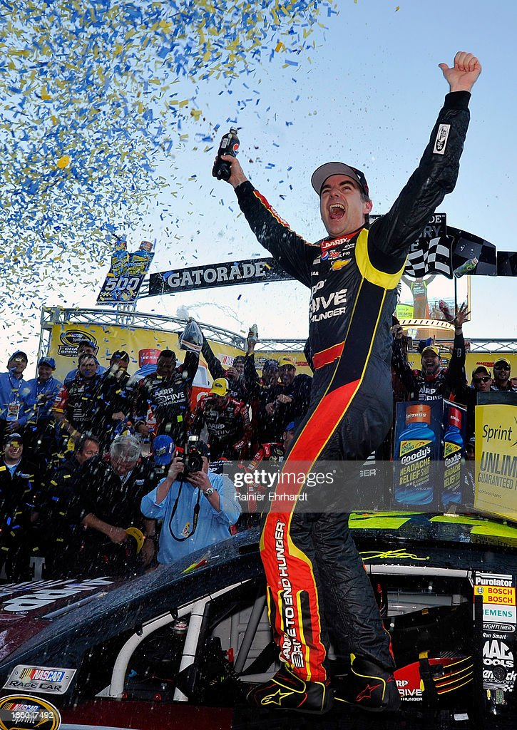 <a gi-track='captionPersonalityLinkClicked' href=/galleries/search?phrase=Jeff+Gordon&family=editorial&specificpeople=171491 ng-click='$event.stopPropagation()'>Jeff Gordon</a>, driver of the #24 Drive To End Hunger Chevrolet, celebrates in victory lane after winning the NASCAR Sprint Cup Series Goody's Headache Relief Shot 500 Powered By Kroger at Martinsville Speedway on October 27, 2013 in Martinsville, Virginia.
