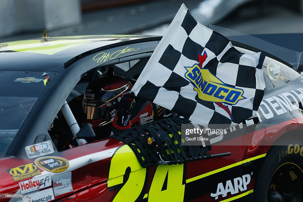 <a gi-track='captionPersonalityLinkClicked' href=/galleries/search?phrase=Jeff+Gordon&family=editorial&specificpeople=171491 ng-click='$event.stopPropagation()'>Jeff Gordon</a>, driver of the #24 Drive To End Hunger Chevrolet, celebrates after winning the NASCAR Sprint Cup Series Goody's Headache Relief Shot 500 Powered By Kroger at Martinsville Speedway on October 27, 2013 in Martinsville, Virginia.
