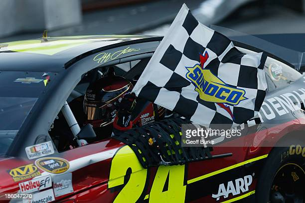 Jeff Gordon driver of the Drive To End Hunger Chevrolet celebrates after winning the NASCAR Sprint Cup Series Goody's Headache Relief Shot 500...