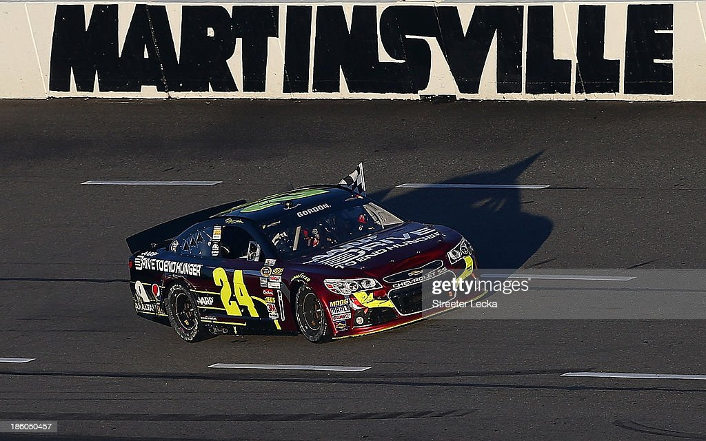<a gi-track='captionPersonalityLinkClicked' href=/galleries/search?phrase=Jeff+Gordon&family=editorial&specificpeople=171491 ng-click='$event.stopPropagation()'>Jeff Gordon</a>, driver of the #24 Drive To End Hunger Chevrolet, celebrates with the checkered flag after winning the NASCAR Sprint Cup Series Goody's Headache Relief Shot 500 Powered By Kroger at Martinsville Speedway on October 27, 2013 in Martinsville, Virginia.