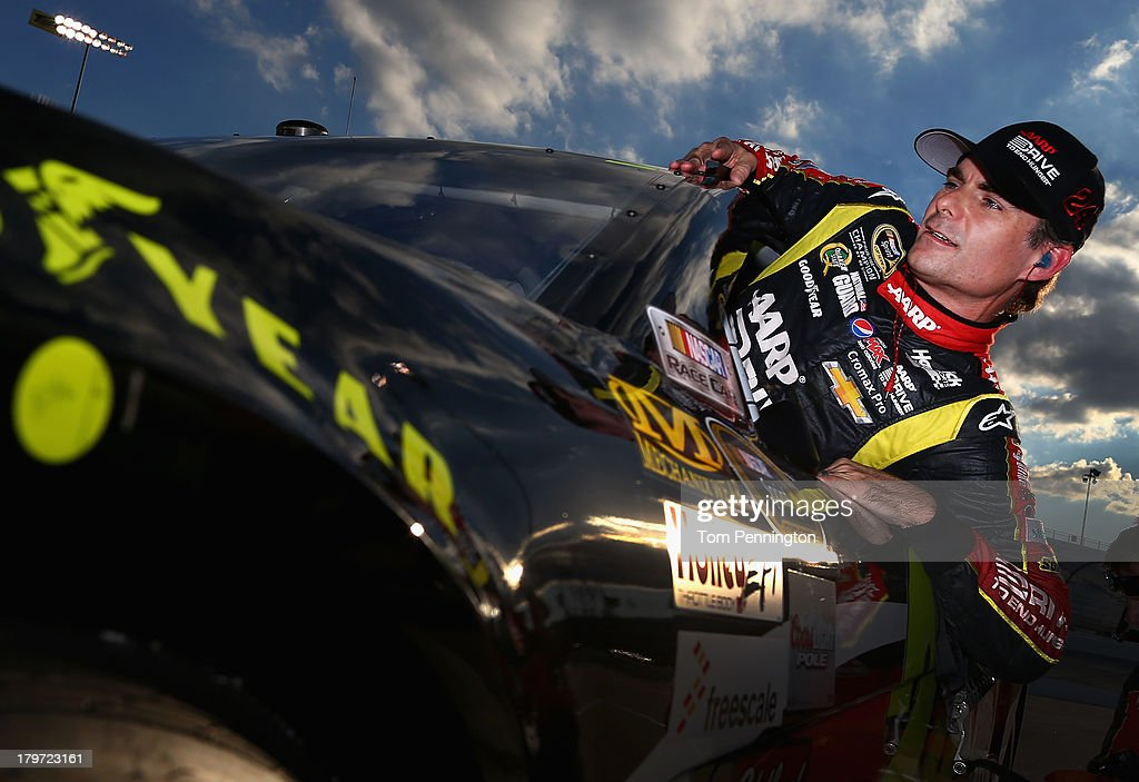 <a gi-track='captionPersonalityLinkClicked' href=/galleries/search?phrase=Jeff+Gordon&family=editorial&specificpeople=171491 ng-click='$event.stopPropagation()'>Jeff Gordon</a>, driver of the #24 Drive to End Hunger Chevrolet, climbs from his car after qualifying for the NASCAR Sprint Cup Series Federated Auto Parts 400 at Richmond International Raceway on September 6, 2013 in Richmond, Virginia.