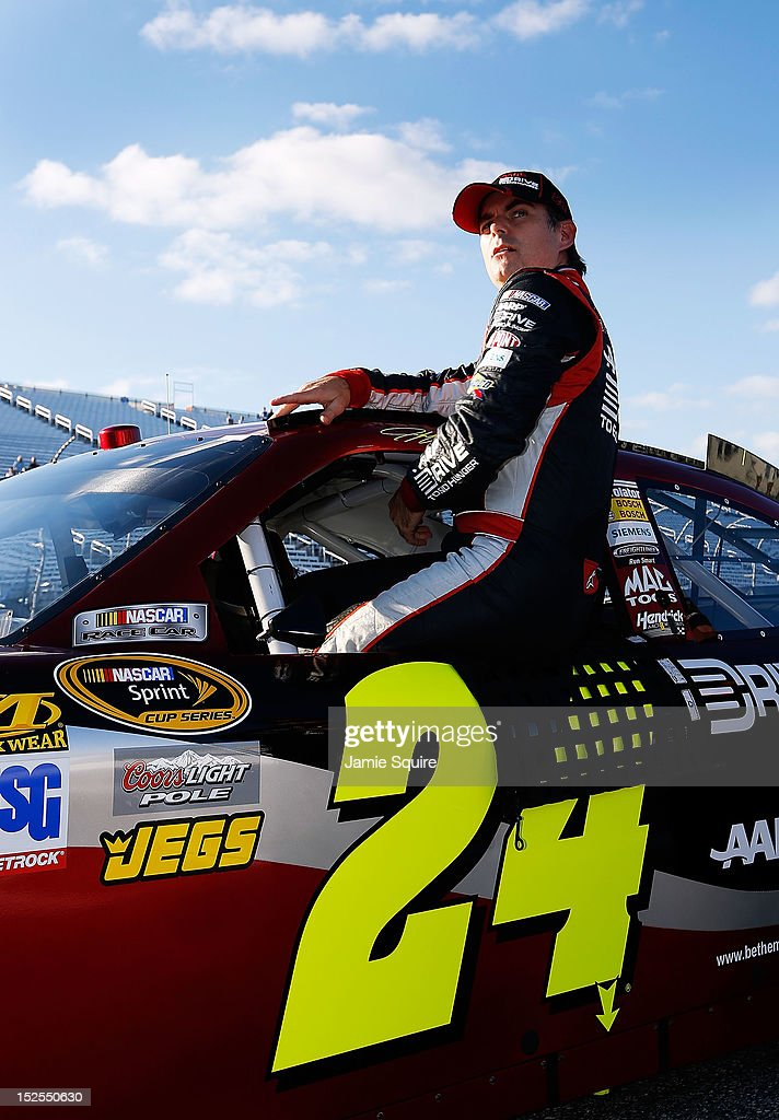 <a gi-track='captionPersonalityLinkClicked' href=/galleries/search?phrase=Jeff+Gordon&family=editorial&specificpeople=171491 ng-click='$event.stopPropagation()'>Jeff Gordon</a>, driver of the #24 Drive to End Hunger Chevrolet, climbs out of his car after qualifying for the NASCAR Sprint Cup Series Sylvania 300 at New Hampshire Motor Speedway on September 21, 2012 in Loudon, New Hampshire.