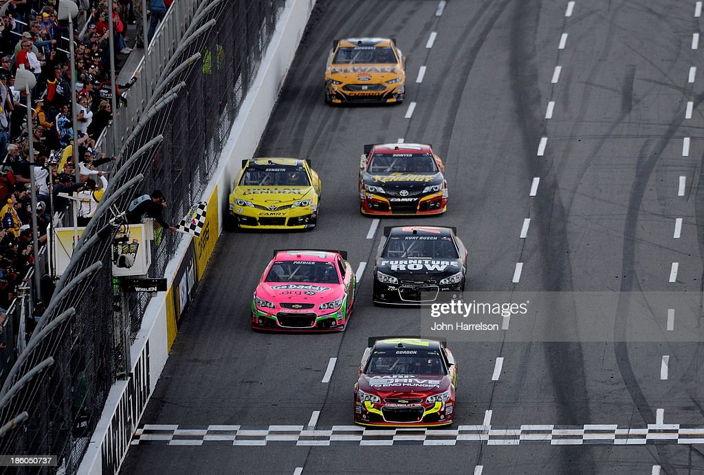 Jeff Gordon, driver of the #24 Drive To End Hunger Chevrolet, crosses the finish line to win the NASCAR Sprint Cup Goody's Headache Relief Shot 500 Powered By Kroger at Martinsville Speedway on October 27, 2013 in Martinsville, Virginia.