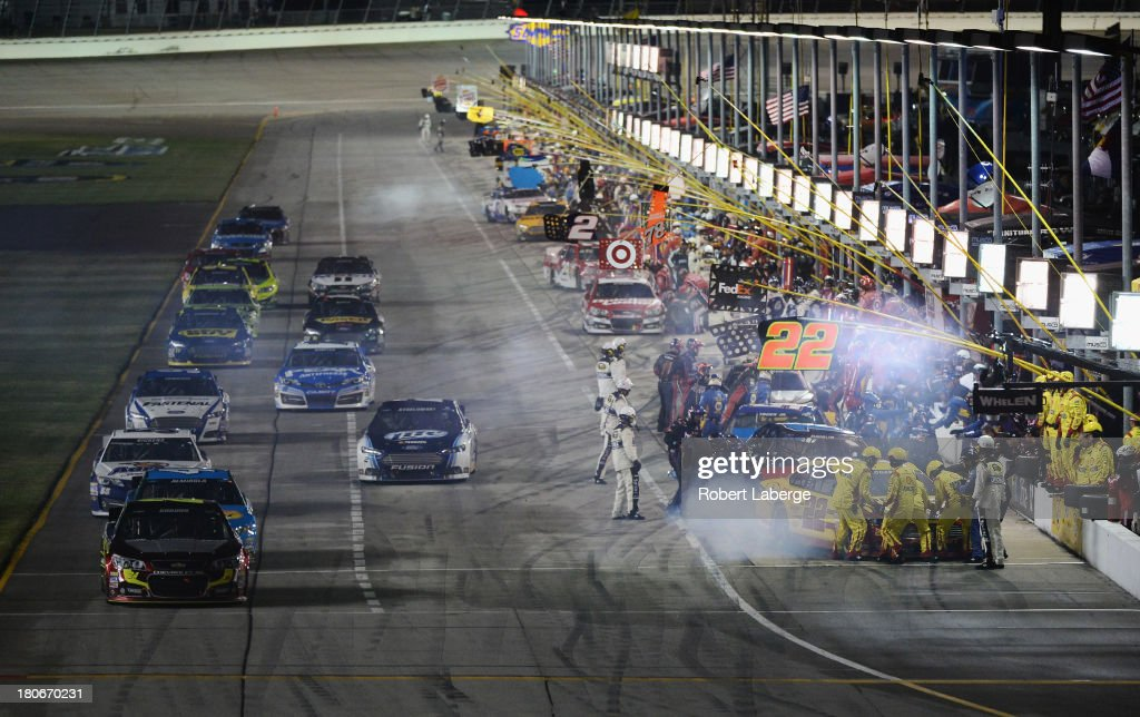 Jeff Gordon, driver of the #24 Drive To End Hunger Chevrolet, drives off pit road during the NASCAR Sprint Cup Series Geico 400 at Chicagoland Speedway on September 15, 2013 in Joliet, Illinois.