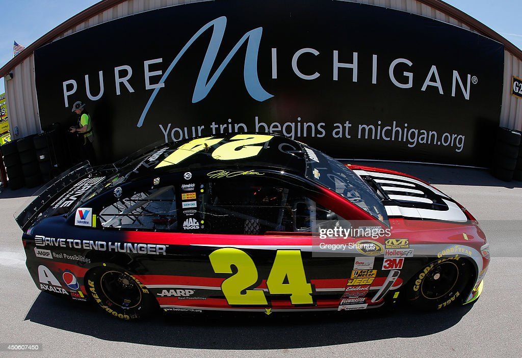 Jeff Gordon, driver of the #24 Drive to End Hunger Chevrolet, drives through the garage area during practice for the NASCAR Sprint Cup Series Quicken Loans 400 at Michigan International Speedway on June 14, 2014 in Brooklyn, Michigan.