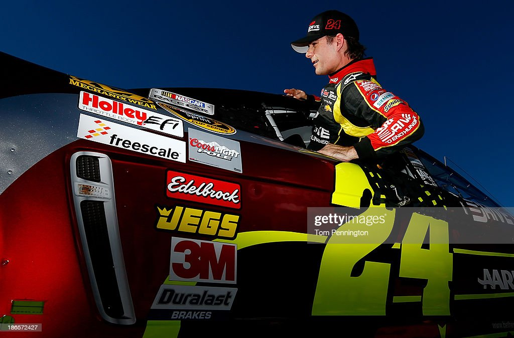 Jeff Gordon, driver of the #24 Drive to End Hunger Chevrolet, gets in his car during qualifying for the NASCAR Sprint Cup Series AAA Texas 500 at Texas Motor Speedway on November 1, 2013 in Fort Worth, Texas.