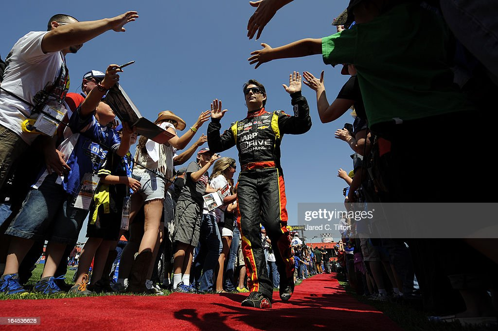 Jeff Gordon driver of the Drive To End Hunger Chevrolet greets fans before the start of the NASCAR Sprint Cup Series Auto Club 400 at Auto Club...