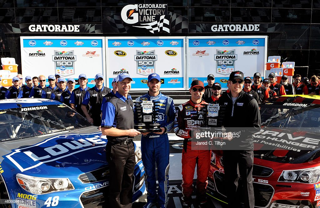 <a gi-track='captionPersonalityLinkClicked' href=/galleries/search?phrase=Jeff+Gordon&family=editorial&specificpeople=171491 ng-click='$event.stopPropagation()'>Jeff Gordon</a>, driver of the #24 Drive To End Hunger Chevrolet, his crew chief, <a gi-track='captionPersonalityLinkClicked' href=/galleries/search?phrase=Alan+Gustafson&family=editorial&specificpeople=3626738 ng-click='$event.stopPropagation()'>Alan Gustafson</a>, <a gi-track='captionPersonalityLinkClicked' href=/galleries/search?phrase=Jimmie+Johnson+-+Piloto+da+Nascar&family=editorial&specificpeople=171519 ng-click='$event.stopPropagation()'>Jimmie Johnson</a>, driver of the #48 Lowe's Chevrolet, and his crew chief, <a gi-track='captionPersonalityLinkClicked' href=/galleries/search?phrase=Chad+Knaus&family=editorial&specificpeople=564401 ng-click='$event.stopPropagation()'>Chad Knaus</a>, pose with the Daytona 500 Pole Award and Front Row Award after qualifying for the pole position and front row for the 57th Annual Daytona 500 at Daytona International Speedway on February 15, 2015 in Daytona Beach, Florida.