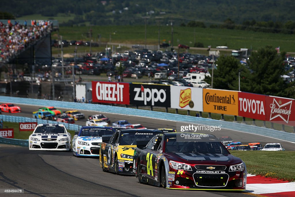 Jeff Gordon driver of the Drive to End Hunger Chevrolet leads a pack of cars during the NASCAR Sprint Cup Series CheezIt 355 at Watkins Glen...